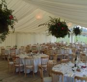 Hanging baskets in wedding marquee
